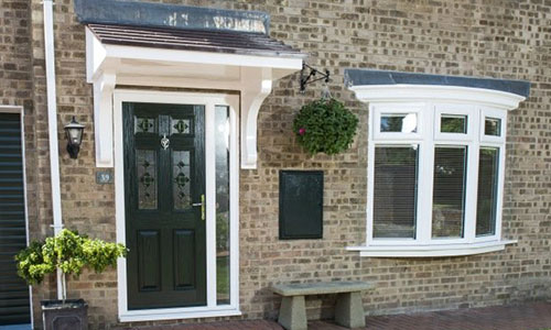 Black Composite door with hanging plant pot, installed in Oxford by Paradise Windows