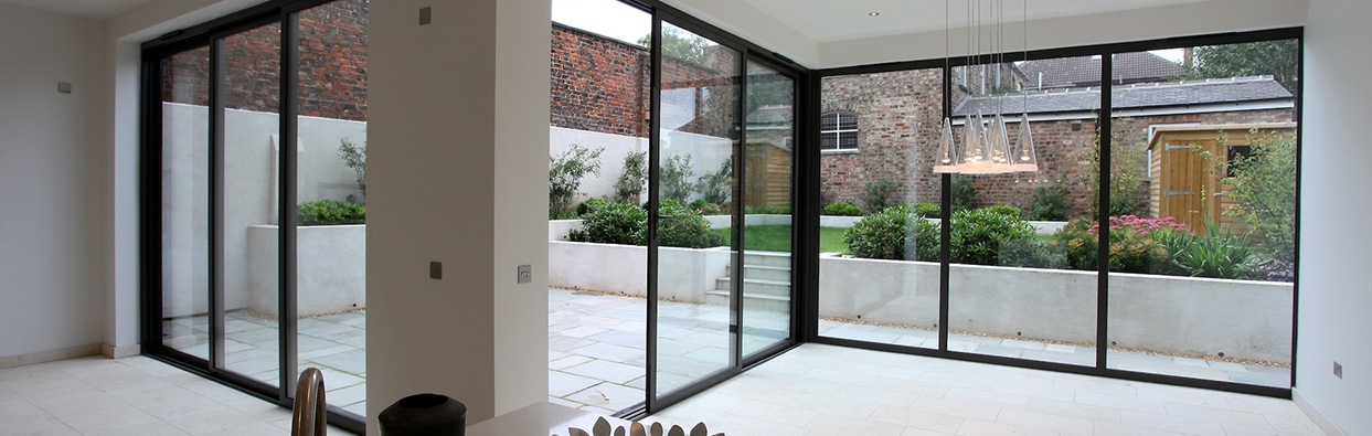Bi-fold doors overlooking modern garden, installed in Oxford by Paradise Windows