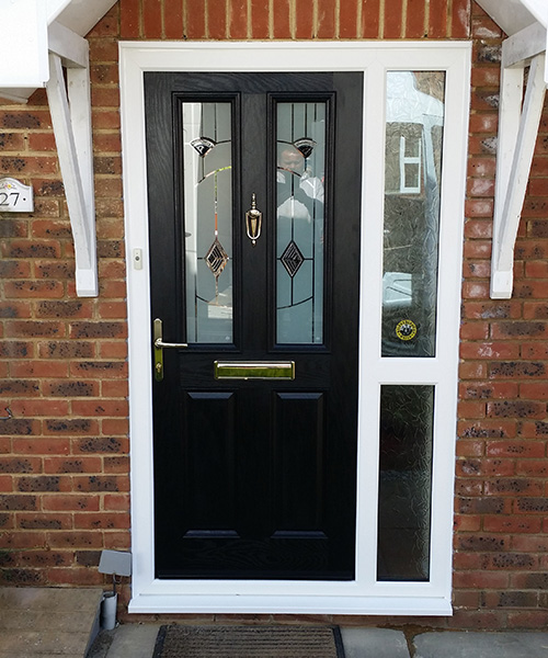 Black Composite Door with stained glass fitted by Paradise Windows