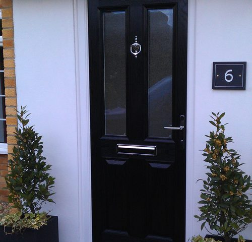 Black Composite door on white house in Oxfordshire fitted by Paradise Windows