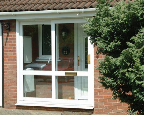 Glass Porch Area with Front Door and uPVC front door both installed by Paradise Windows