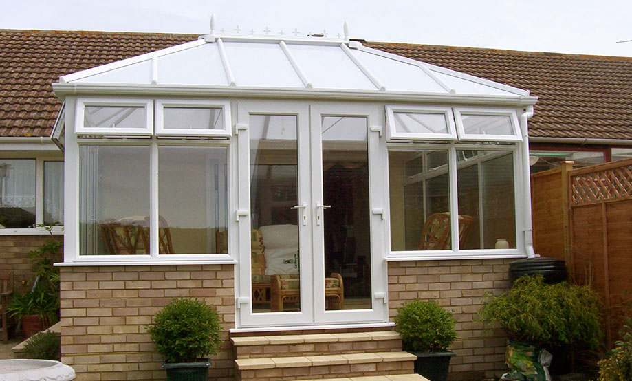 Edwardian Conservatory made from uPVC with French Double Doors opening onto Back Garden. Installed in Oxfordshire