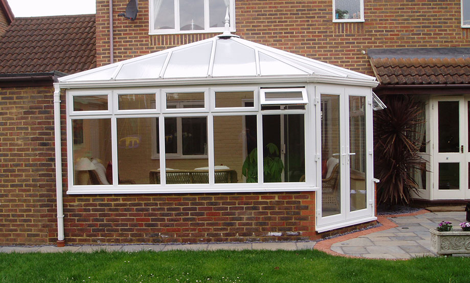 Large Edwardian Conservatory with French Double Doors opening onto Back Garden. Installed in Oxford