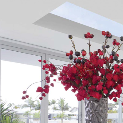 Bunch of Red Flowers in Modern Room with a Lantern Roof